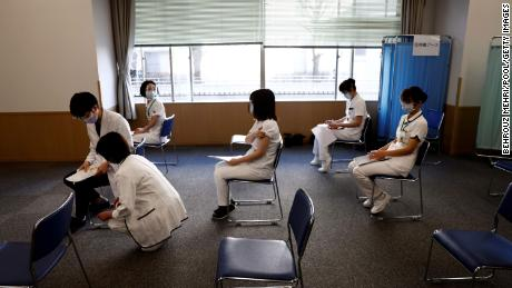 Medical workers wait for consultations after receiving a dose of the Covid-19 vaccine in Tokyo on February 17, 2021.