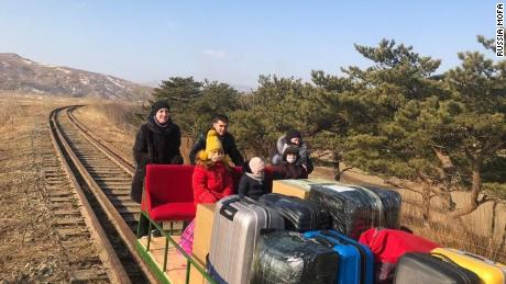 Russian diplomats working in the Pyongyang embassy had to use a handcar as they returned home from North Korea with their family members.
