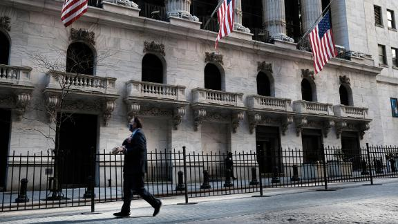 NEW YORK, NEW YORK - FEBRUARY 25: People walk by the New York Stock Exchange (NYSE) on February 25, 2021 in New York City. As a rapid rise in Treasury yields has made equity investors nervous, stocks fell on Thursday with the Dow down 500 points in afternoon trading. (Photo by Spencer Platt/Getty Images)