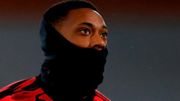 Manchester United's French striker Anthony Martial warms up for the English Premier League football match between Fulham and Manchester United at Craven Cottage in London on January 20, 2021. (Photo by Adrian DENNIS / POOL / AFP) / RESTRICTED TO EDITORIAL USE. No use with unauthorized audio, video, data, fixture lists, club/league logos or 'live' services. Online in-match use limited to 120 images. An additional 40 images may be used in extra time. No video emulation. Social media in-match use limited to 120 images. An additional 40 images may be used in extra time. No use in betting publications, games or single club/league/player publications. /  (Photo by ADRIAN DENNIS/POOL/AFP via Getty Images)