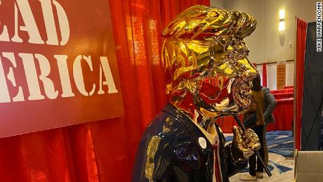 A golden Trump statue is displayed at the 2021 Conservative Political Action Conference