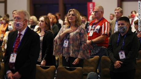 People listen to the national anthem during the opening of the Conservative Political Action Conference at the Hyatt Regency on February 26, 2021 in Orlando, Florida.