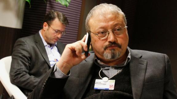 FILE - In this Jan. 29, 2011 file photo, Saudi journalist Jamal Khashoggi speaks on his cellphone at the World Economic Forum in Davos, Switzerland. Saud Al-Mojeb, Saudi Arabia