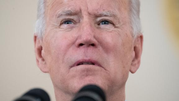"""US President Joe Biden speaks about lives lost to Covid after death toll passed 500,000, in the Cross Hall of the White House in Washington, DC, February 22, 2021. - President Joe Biden called the milestone of more than 500,000 US deaths from Covid-19 """"heartbreaking"""" on Monday and urged the country to unite against the pandemic. """"I know what it's like,"""" an emotional Biden said in a national television address, referring to his own long history of family tragedies. (Photo by SAUL LOEB / AFP) (Photo by SAUL LOEB/AFP via Getty Images)"""