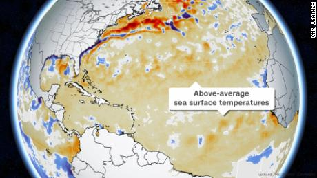 Above average sea surface temperatures across the Atlantic Basin are seen in orange. Red areas indicate temperatures that are well above average for late February. White areas indicate near-average temperatures.