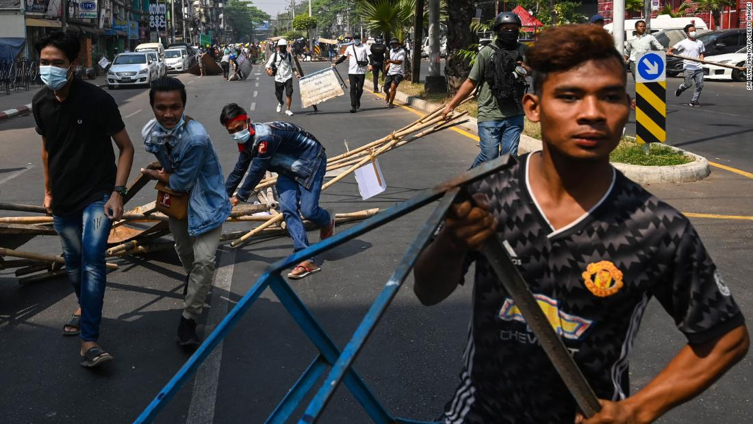 Protesters erect barricades during a demonstration in Yangon on February 28.