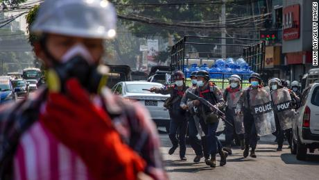 Riot police charge at anti-coup protesters on February 27, 2021 in Yangon, Myanmar.