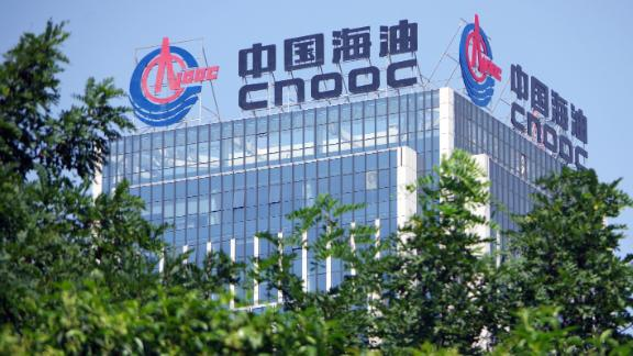 A signboard of CNOOC (China National Offshore Oil Corporation) is displayed on the rooftop of a building in Ji'nan city, east China's Shandong province.