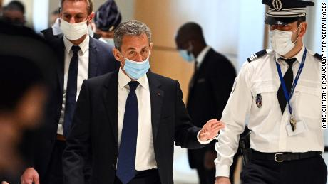 The former French president arrives to hear the final verdict in the corruption trial on Monday.