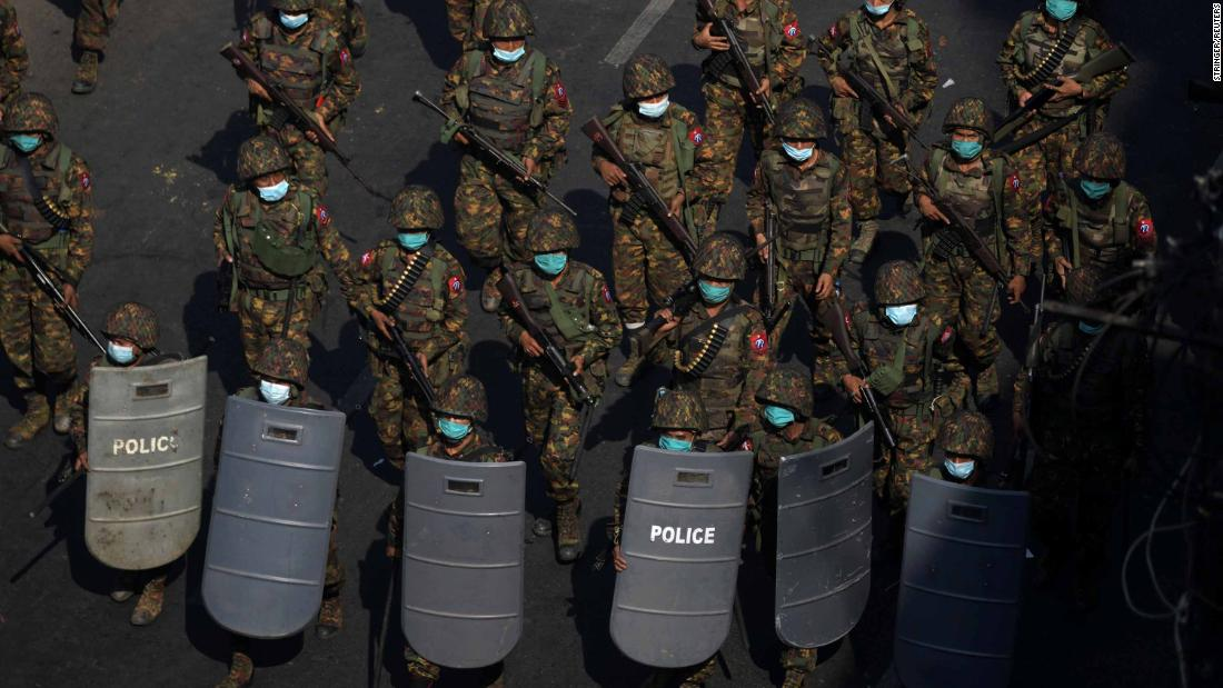 Soldiers patrol during a protest in Yangon on February 28.