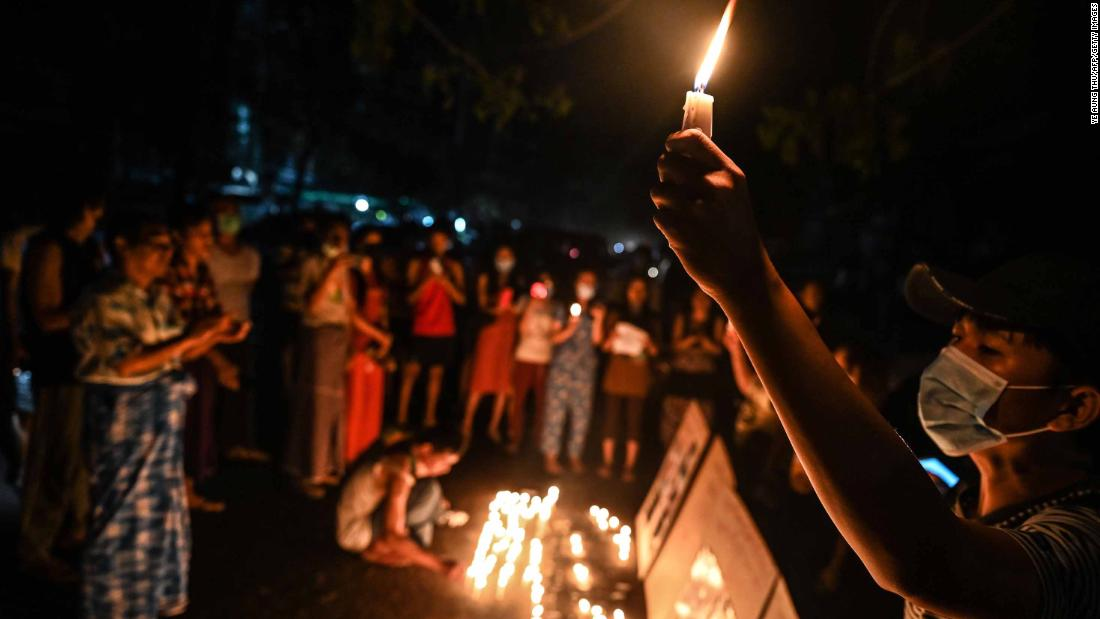 People in Yangon take part in a ceremony on February 28 to remember those who have been killed during demonstrations.