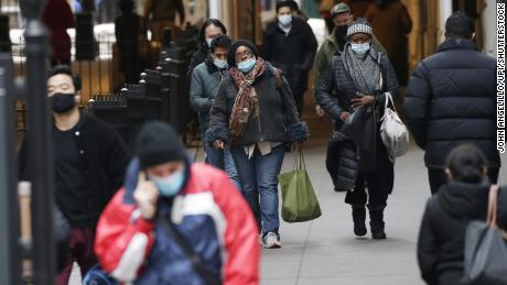 Pedestrians walk wearing face masks to help prevent the spread of coronavirus in New York City on February 22.