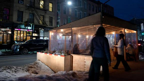 People continue to eat in dining pods despite indoor dining opening back up on Valentine's Day on February 14, 2021 in the Brooklyn borough of New York City. (Photo by Michael Loccisano/Getty Images)