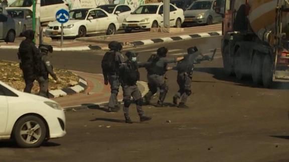 Police shoot stun grenades at Arab Israelis protesting an increase in gang violence in their towns.