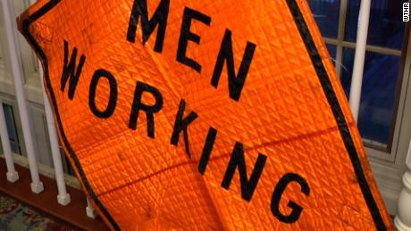 """""""Men Working"""" sign"""