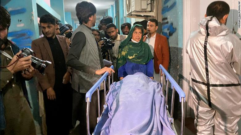 Afghans carry the body of a woman who was killed in Jalalabad, Afghanistan, on March 2.