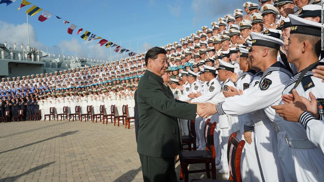 Chinese President Xi Jinping, meets with representatives of the aircraft carrier unit and the manufacturer at a naval port in Sanya, south China's Hainan province on Dec. 17, 2019.