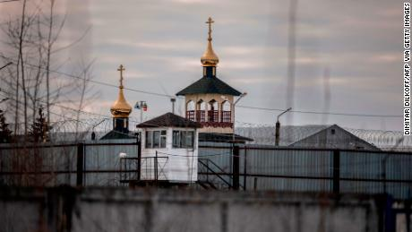 An Orthodox church is seen behind the barriers of Penal Colony No. 2.