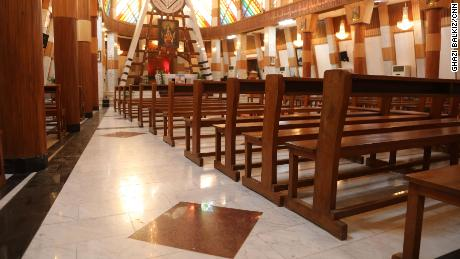The dark red squares on the floor scattered throughout the Our Lady of Salvation church mark the places where people died as terrorists laid siege to the church. Pope Francis is set to meet with a small gathering at this church on Friday, the first day of his historic visit.