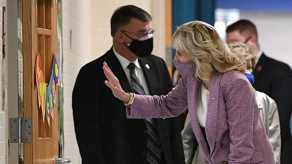US First Lady Jill Biden (L) waves to students in a classroom as she tours Benjamin Franklin Elementary School with US Education Secretary Miguel Cardona (R) in Meriden, Connecticut, on March 3, 2021. - , (Photo by MANDEL NGAN / POOL / AFP) (Photo by MANDEL NGAN/POOL/AFP via Getty Images)