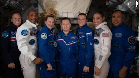 The seven-member crew of Expedition 64 posed for a portrait on the International Space Station.  On the left are NASA astronauts Shannon Walker, Victor Glover and Kate Rubins;  Roscosmos cosmonauts Sergei Ryzhikov and Sergei Kud-Sverchkov;  NASA astronaut Michael Hopkins;  and JAXA astronaut Soichi Noguchi.