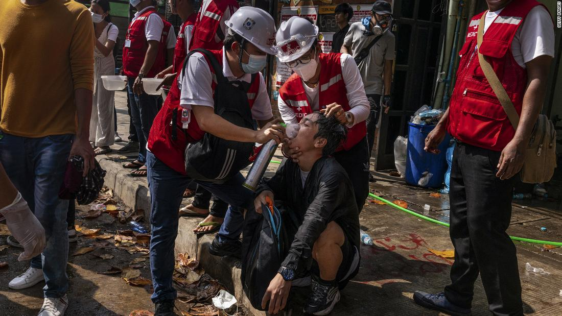 Medics help supply oxygen to a protester who was exposed to tear gas in Yangon on March 3.
