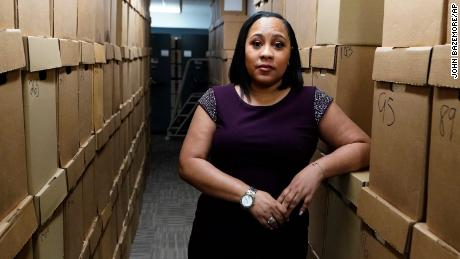 Fulton County District Attorney Fani Willis poses among boxes containing thousands of primal cases at her office, Wednesday, February 24, 2021, in Atlanta.