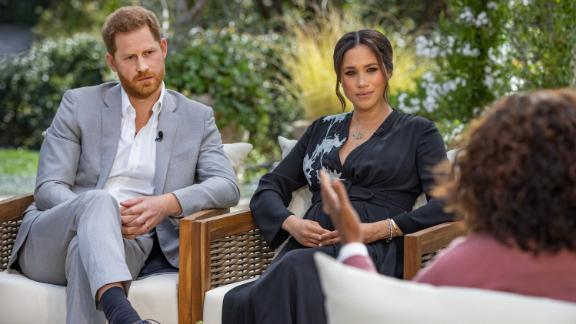 """Britain's Prince Harry and his wife Meghan, the Duchess of Sussex, are pictured during their <a href=""""https://www.cnn.com/2021/03/07/uk/oprah-harry-meghan-interview-intl-hnk/index.html"""" target=""""_blank"""">interview with Oprah Winfrey,</a> which aired in the United States on Sunday, March 7. It was their first sit-down appearance since leaving Britain last year."""
