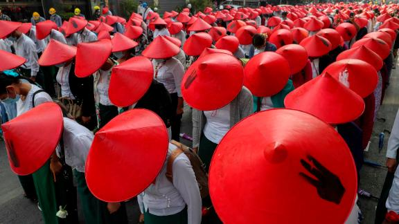 Schoolteachers wear traditional hats while participating in an anti-coup demonstration in Mandalay on March 3.