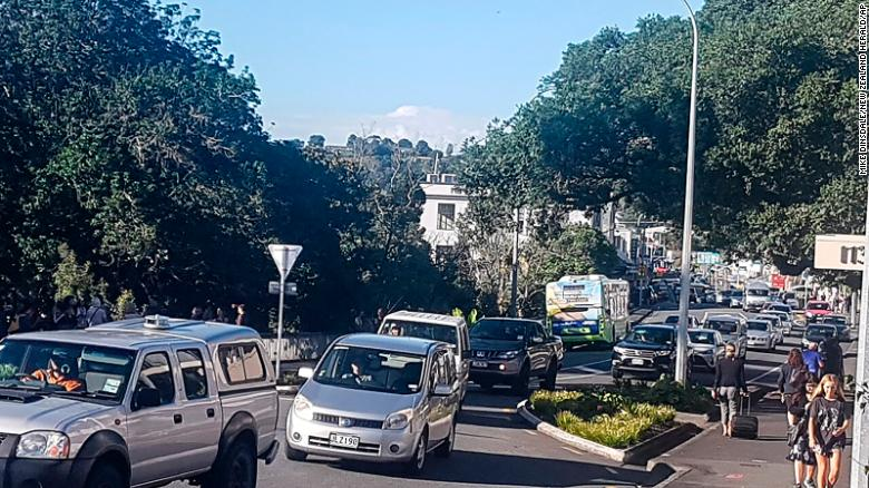 Traffic slowly works up to high ground at Whangarei, New Zealand, as a tsunami warning is issued Friday, March 5, 2021.
