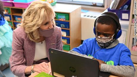 US First Lady Jill Biden speaks with a student as she tours Benjamin Franklin Elementary School in Meriden, Connecticut, on March 3, 2021.