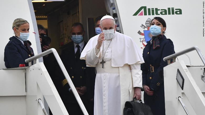 Pope Francis waves as he boards a plane for Iraq on March 5, 2021 at Rome's Fiumicino airport.