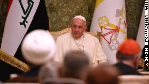 Pope Francis attends a meeting at Iraq's presidential palace in Baghdad.