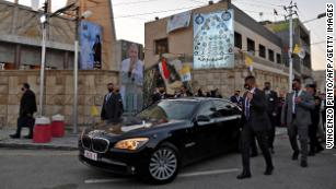 """The Pope leaves a Baghdad church, Our Lady of Salvation, on Friday. The church was the site of <a href=""""http://cnn.com/2021/03/04/middleeast/iraq-pope-christians-intl/index.html"""" target=""""_blank"""">a massacre in 2010.</a>"""