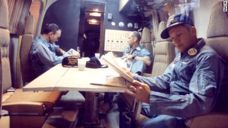 Within the Mobile Quarantine Facility, Apollo 11 astronauts (left to right) Michael Collins, Edwin E. Aldrin Jr. and Neil A. Armstrong relax following their successful lunar landing mission. They spent two-and-one-half days in the quarantine trailer enroute from the USS Hornet, prime recovery ship, to the Lunar Receiving Laboratory at the Manned Spacecraft Center in Houston. The Hornet docked at Pearl Harbor where the trailer was transferred to a jet aircraft for the flight to Houston.