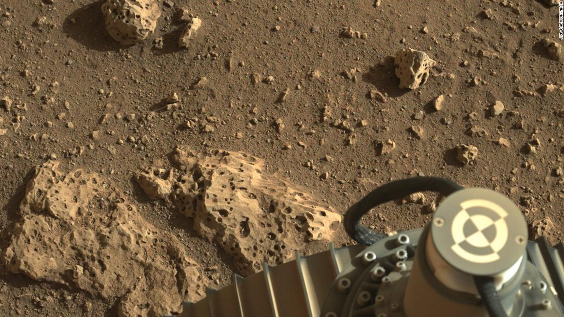 This image shows the rover's wheel on the surface of the red planet.