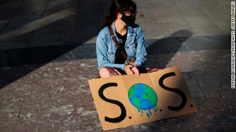 A girl with a sign in Plaza del Carmen Square on September 25, 2020 in Granada, Spain. Following the call of Greta Thunberg for a World School Strike and 'Fridays for future', students took to the streets to denounce government inaction towards the climate crisis.