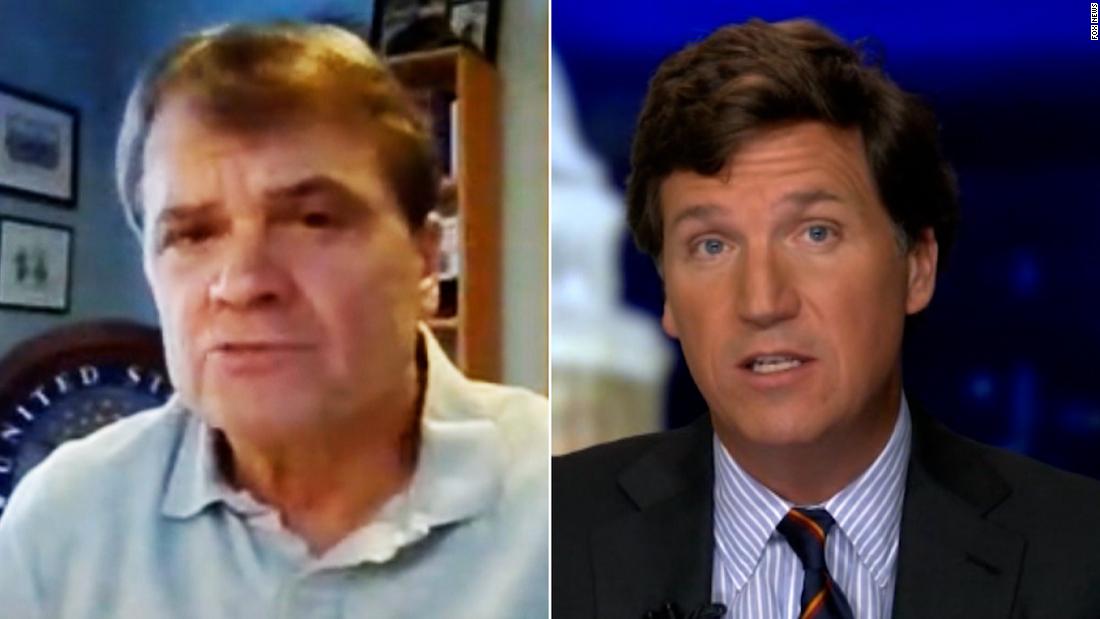 Tucker Carlson calls QAnon supporters 'gentle people.' Lawmaker fires back