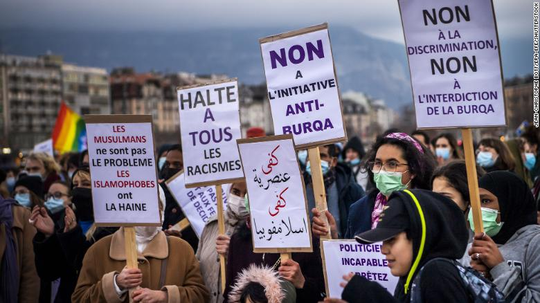 """Activists demonstrate against the """"anti-burqa"""" initiative in Geneva on March 5, 2021."""