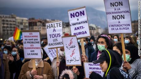 "Activists demonstrate against the ""anti-burqa"" initiative in Geneva on March 5, 2021."
