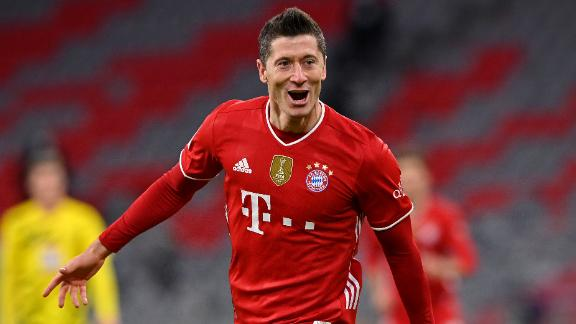 MUNICH, GERMANY - MARCH 06: Robert Lewandowski of FC Bayern Muenchen celebrates after scoring their side's fourth goal, completing his hat-trick during the Bundesliga match between FC Bayern Muenchen and Borussia Dortmund at Allianz Arena on March 06, 2021 in Munich, Germany. Sporting stadiums around Germany remain under strict restrictions due to the Coronavirus Pandemic as Government social distancing laws prohibit fans inside venues resulting in games being played behind closed doors. (Photo by Sebastian Widmann/Getty Images)