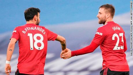 Luke Shaw (R) celebrates scoring Manchester United's second goal.