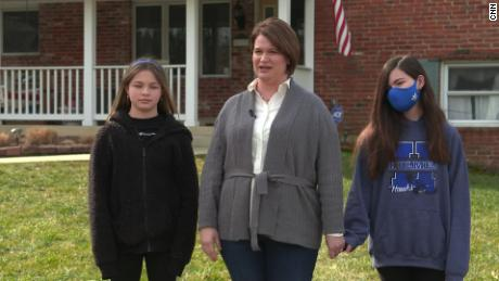 Sixth-graders Elizabeth (left) and Katharine Porter are split about whether to return to classrooms, their mother Jennfer says.
