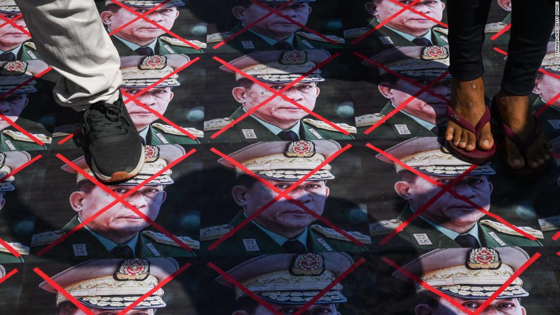 Protesters step on portraits of Myanmar's armed forces chief, Gen. Min Aung Hlaing, during a demonstration in Yangon on March 5.