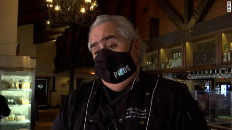 Arnaldo Richards is keeping a mask requirement to protect his family, staff and customers.