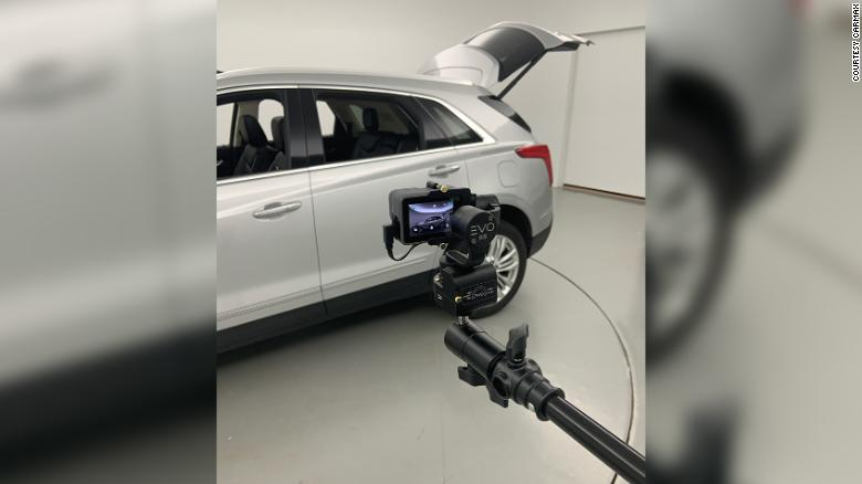 An SUV about to be listed for sale on CarMax's website is photographed using a camera that will create a fully rotatable 360-degree image.