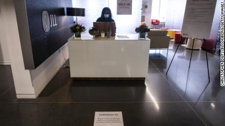 A social distancing marker is displayed in front of a reception desk at the JLL office in Chicago.