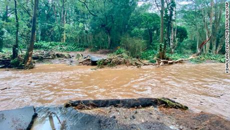 Floodwaters overcome a bridge off Behe Road in Haikou, Maui.