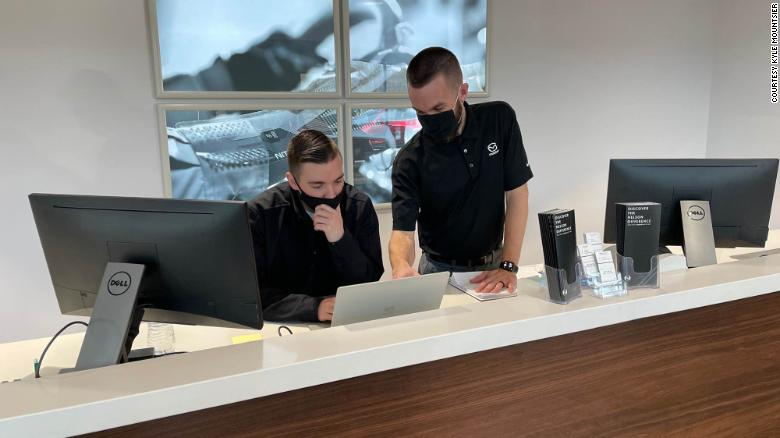 Online sales have dramatically changed business for Kyle Mountsier (standing), the marketing and business development director for Nelson Mazda in Franklin, Tennessee, who is seen here with team leader Tanner Hostetter.