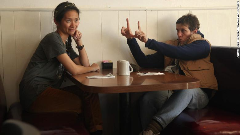 "Writer/director Chloé Zhao on the set of ""Nomadland"" with actor and producer Frances McDormand."
